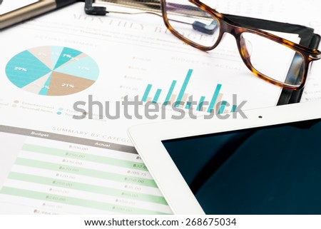 Document financial with tablet .profit