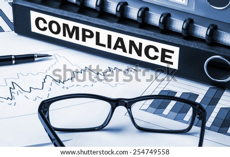 document folder with the label compliance - stock photo