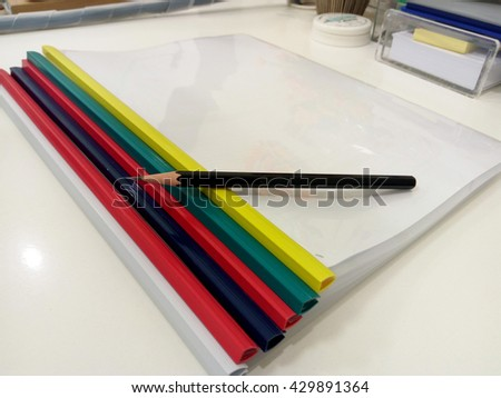document folders and pencil on the table