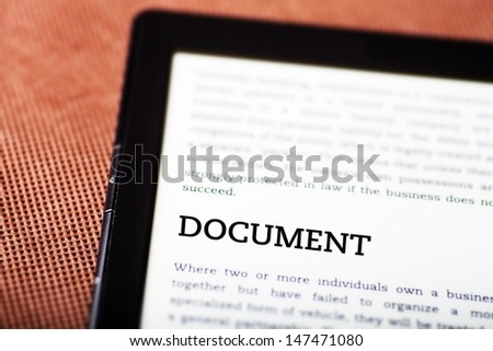 Document on ebook, tablet pc concept - stock photo