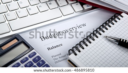 document with title budget overview and office tools close up