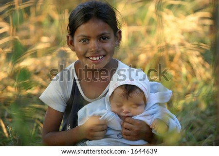 Documentary: a gipsy girl with a little child - stock photo