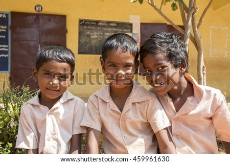 Documentary image. Pondicherry, Tamil Nadu,India - May 12 2014. School students in school, out school, in groups, with uniforms. In government school