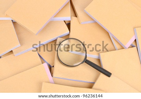Documents and magnifier - stock photo