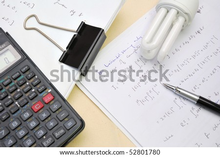 Documents and notes on math equations with light bulb signifying solution to problems. Also for study and education, research and analysis, and work and business concepts.