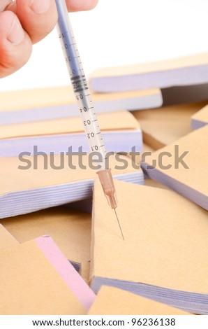 Documents and syringe - stock photo