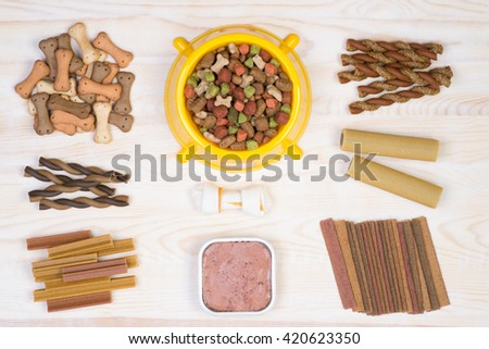 Dod food selection on white, wooden background, top view - stock photo
