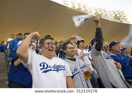 Dodger fans cheering during National League Championship Series (NLCS), Dodger Stadium, Los Angeles, CA on October 12, 2008 - stock photo