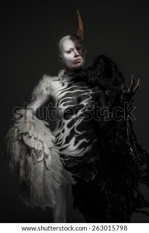 Dody art demon woman isolated on dark grey - stock photo