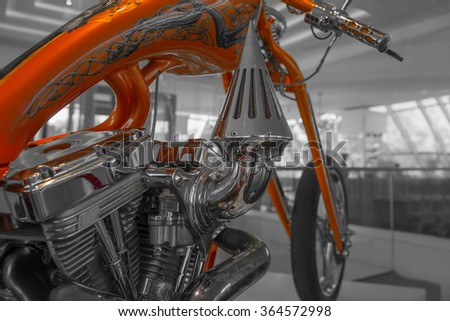Doebern, Brandenburg, Germany - October 27., 2015.; Color detail and the engine of a motorcycle on black and white background.