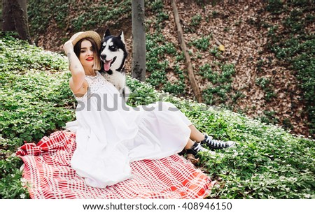 dog and his mistress went for a walk in nature - stock photo