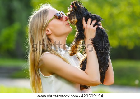 Dog and his owner - Cool puppy and young women having fun in a park - Concepts of friendship,pets,togetherness - stock photo