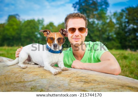 dog and owner  together , very close  having a good time outdoors - stock photo