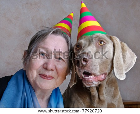 Dog and senior woman - stock photo