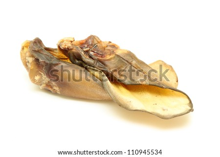 Dog beef ear for chewing isolated on a white background - stock photo