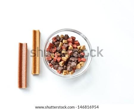 Dog bone and dog candy on white background - stock photo
