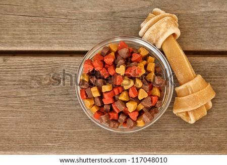 Dog bone and dog candy on wood background - stock photo