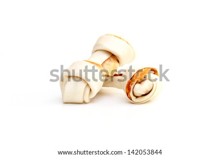 Dog bone for chewing isolated on a white background - stock photo