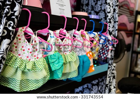 Dog dresses hung up in a store - stock photo
