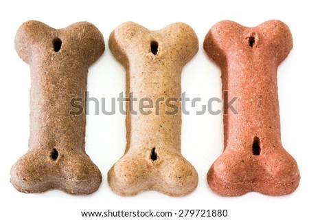 Dog dry food bone shaped on white background - stock photo