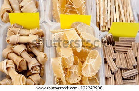 Dog favourite food with bone shoe and stick shapes - stock photo