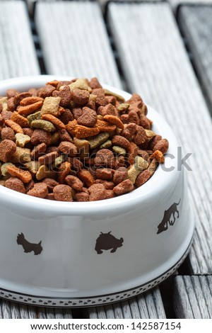 Dog food in bowl white. - stock photo