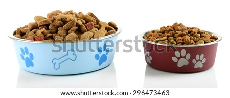Dog food in bowls, isolated on white