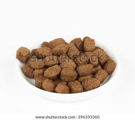 Dog food on white plate on white background