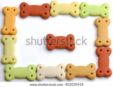 Dog food, Pile of dog biscuits in the shape of a bone for pet food, in square frame shape for background use. - stock photo