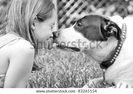 Dog giving girl sweet lick - stock photo