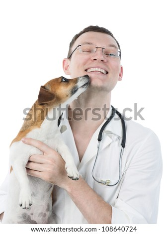 Dog licking a vet, isolated on white. veterinarian is holding Jack Russell terrier - stock photo