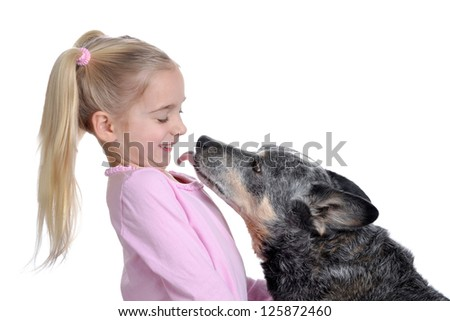 dog licking young girl - stock photo