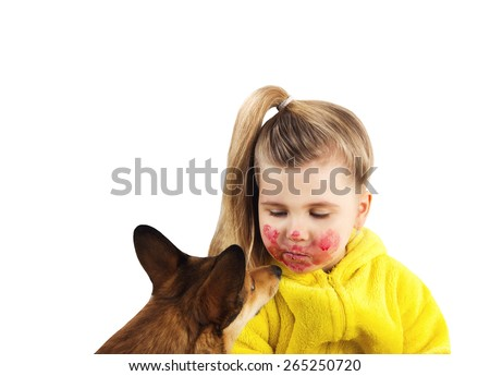 Dog sniffs girl smeared on her face - stock photo