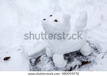Dog statue making from snow, snowman