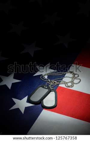 dog tag on U.S. flag