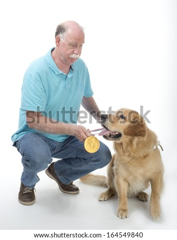 Dog won a golden medal isolated on white - stock photo