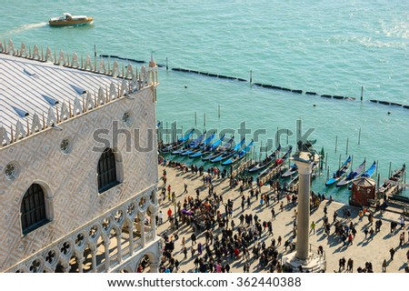 Doge's Palace (Palazzo Ducale) and touristic crowd on the at St. Mark's Square during the Carnival in Venice (Italy). A view from above. - stock photo