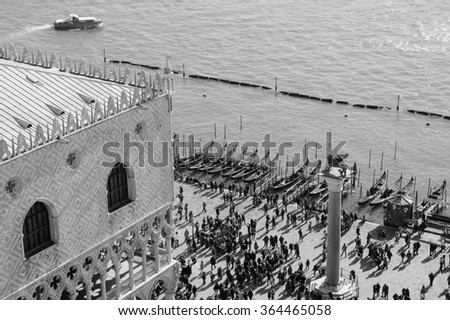 Doge's Palace (Palazzo Ducale) and touristic crowd on the at St. Mark's Square during the Carnival in Venice (Italy). A view from above. Aged photo. Black and white. - stock photo
