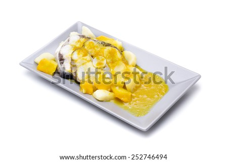 Dogfish marinated in sauce, and potatoes, yellow - stock photo