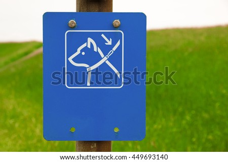 Dogs on leash sign in the park - stock photo