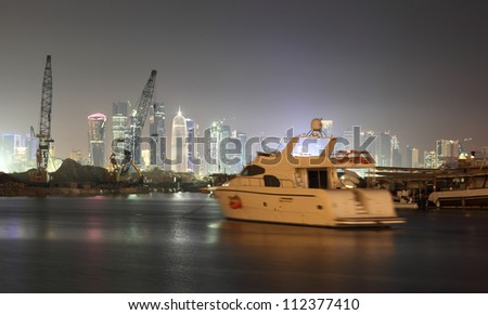 Doha city skyline at night, Qatar, Middle East - stock photo