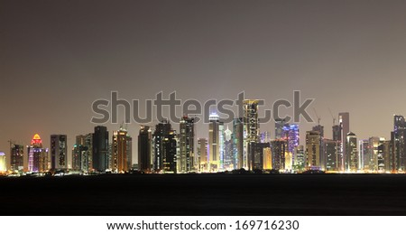 Doha downtown skyline at night, Qatar, Middle East - stock photo
