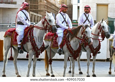 DOHA - MARCH 1 : Police on horse in traditional clothes at 1 March, 2015 in Doha, Qatar. Doha has a unique police squad wearing traditional Arabic costume.