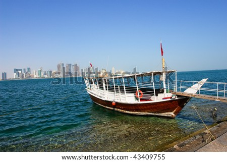 Doha Qatar  - A trip dhow waits for customers - stock photo