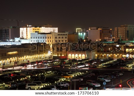 DOHA, QATAR - DEC 15: Parking lot and square at the Souq Waqif at night. December 15 2013 in Doha, Qatar, Middle East