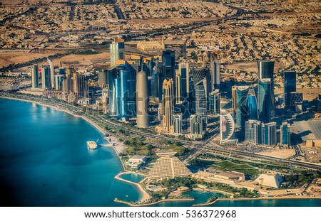 DOHA, QATAR - DECEMBER 12, 2016: Aerial view of city skyline. Doha is a fast growing business center in middle east.