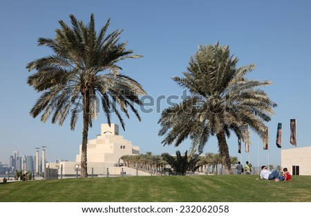 DOHA, QATAR - JAN 6: Palm Trees in front of the Museum of Islamic Art in Doha. January 6, 2012 in Doha, Qatar, Middle East
