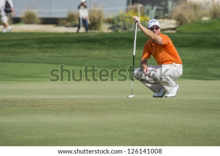 DOHA, QATAR - JANUARY 26: Garth Mulroy cheks out the putting green on the 9th hole during the US$2.5 million Commercial Bank Qatar Masters on January 26, 2013 in Doha Qatar.