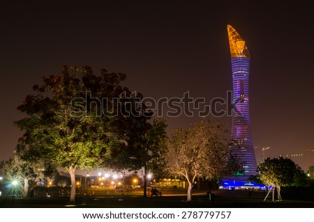 DOHA, QATAR - MAY 17: The Aspire Park and Aspire Tower or Torch Hotel in Doha Sports City at night. May 17, 2015 in Doha, Qatar, Middle East