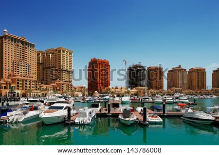 DOHA, QATAR-MAY 3: The Pearl-Qatar on May 3, 2013 in Doha. The Pearl-Qatar is an artificial island with a residential development of luxury villas and apartment towers target at the wealthy community